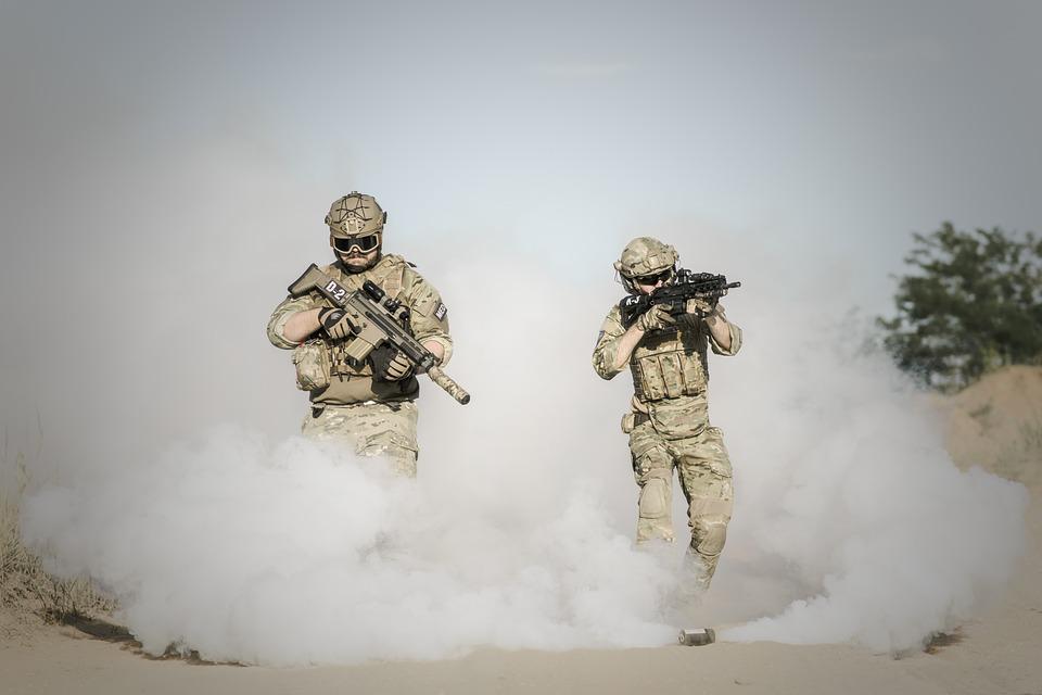 https://jooinn.com/men-holding-rifle-while-walking-through-smoke-grenade.html